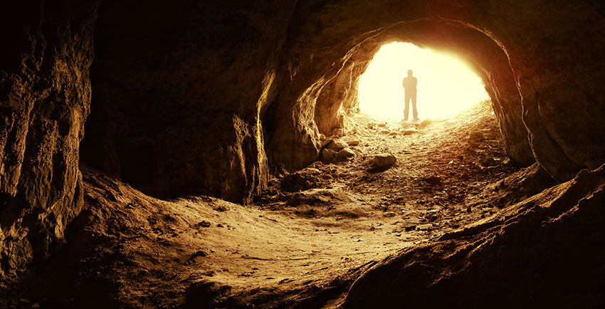 Possibility In Business man standing in cave